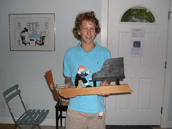 Sam's woodshop project depicting himself playing the piano.
